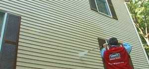 Pressure or power wash home siding with Lowe's