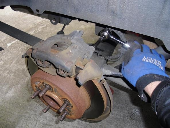 How to Change Rear Disc Brakes on a 2001 Chrysler Town & Country Minivan