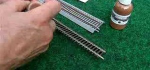 Paint model railroad tracks