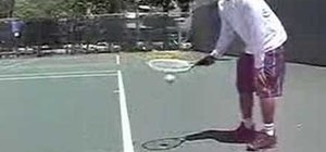 Pick up tennis balls with your racquet