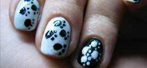 Create a paw print manicure nail design
