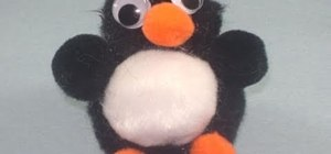 Make a fun little penguin out of pom poms and glue