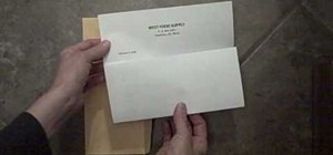Properly fold a letter and place it into an envelope