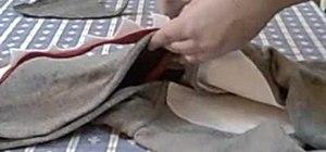 Sew fins and teeth onto a shark costume