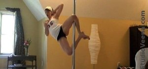 Do a knee hold in pole dancing