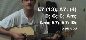 "Play ""Mrs. Robinson"" by Simon and Garfunkel on guitar"