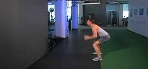 Do a medicine ball squat thrust with a wall rebound