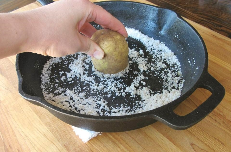 Give Your Dirty Cast Iron Pans a Salted Spud Scrub