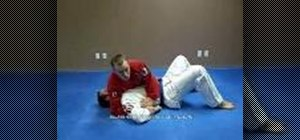Do a Jiu Jitsu Kimura shoulder lock from a side mount