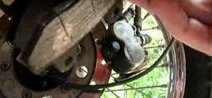 Replace a brake pad on a Honda Rebel 250 motorcycle