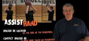 Use the assist hand to shoot a basketball