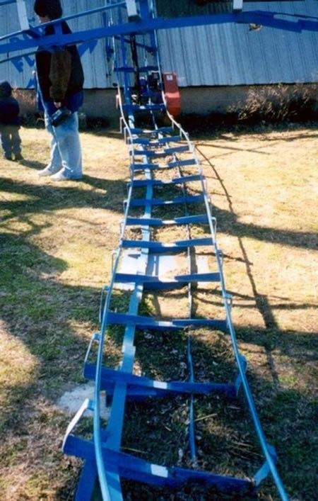 Roller Coaster In Their Backyard : diy backyard roller coaster does 360 loop diy backyard roller coaster