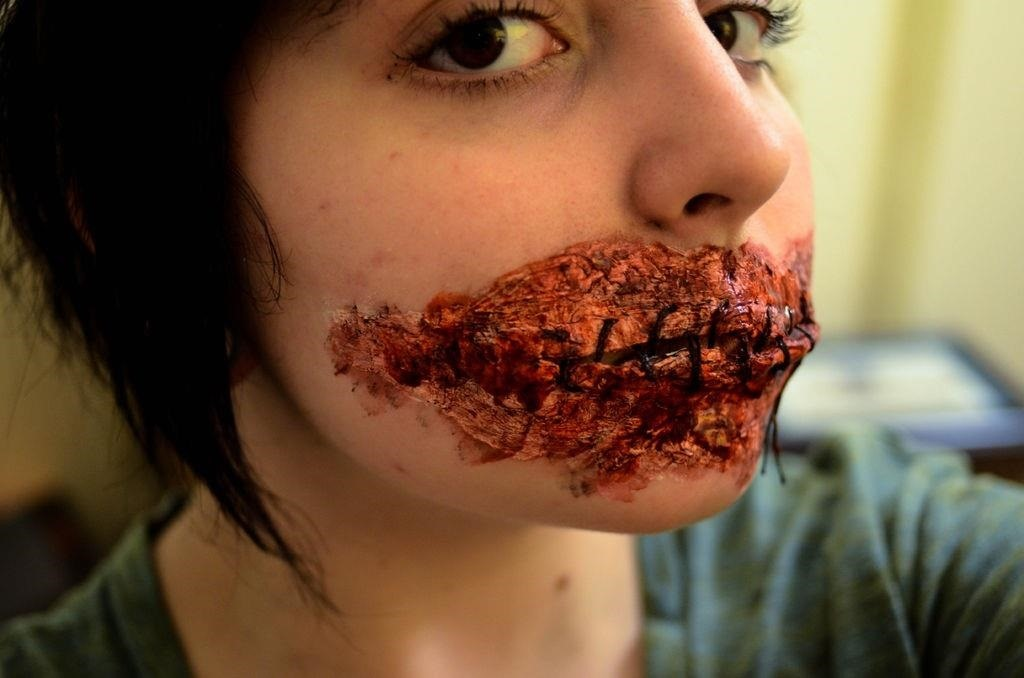 Keep Your Mouth Shut: This DIY Sewn Lips Look for Halloween Is Bloody Gruesome