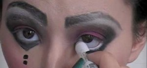 Create a scary pretty marionette doll makeup look for Halloween