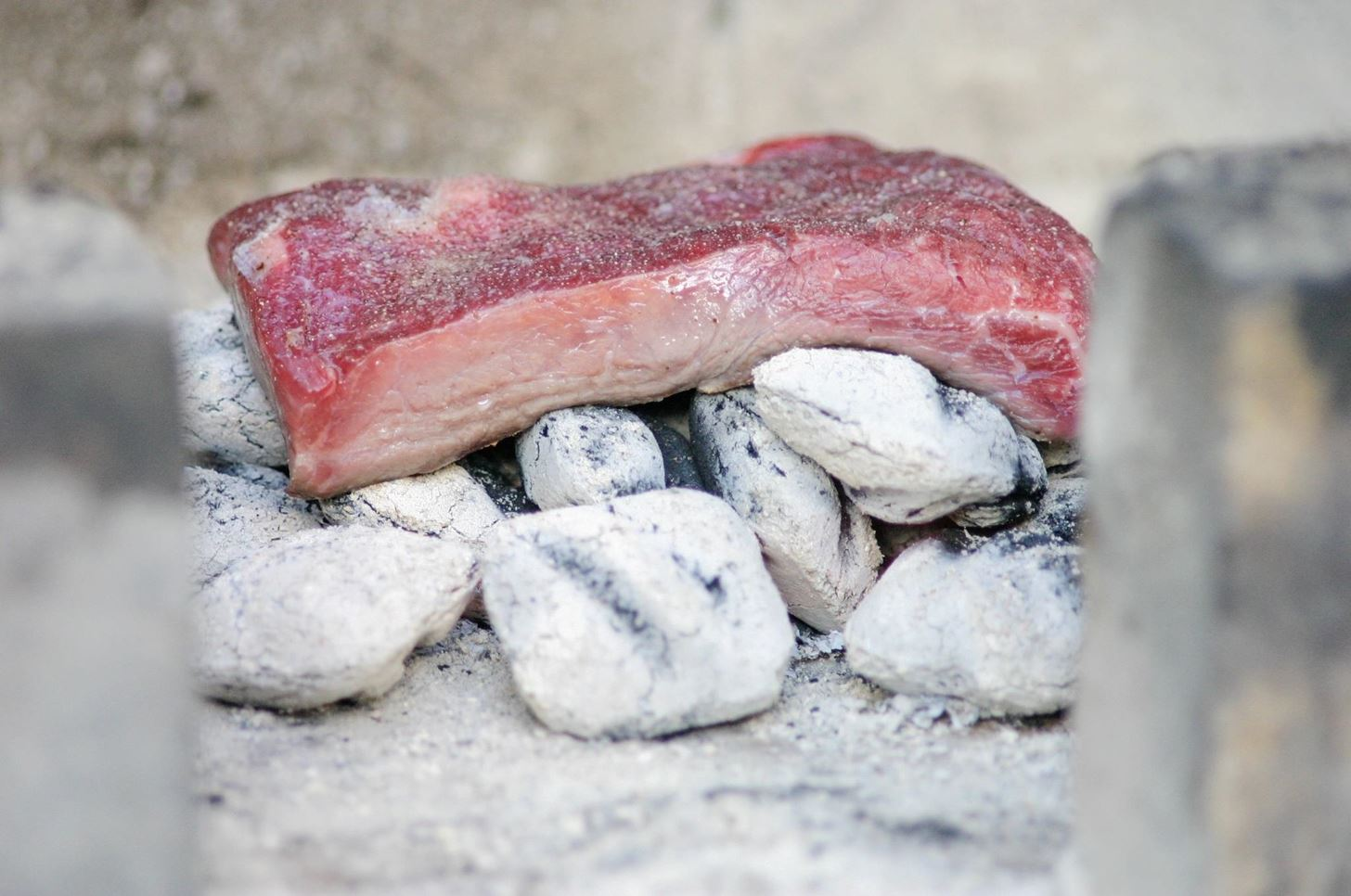 Cook Meat Directly on the Coals for Intense, Fire-Seared Flavor