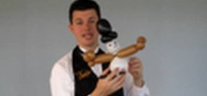 Tie a party balloon snowman figure with a top hat