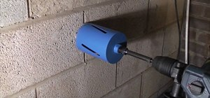 Use and operate a Bosch diamond core drill to put a hole in your wall