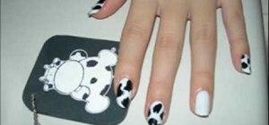 Create a cowprint manicure