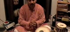 Play the teen tall, or 16-beat, theka on the tabla