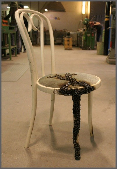 Artist Burns Chairs into Decorative, Fragile Steel Ring Seats with Fire