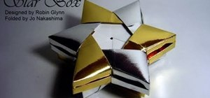 Fold a metallic gold and silver Christmas star gift box