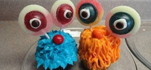 Decorate cute alien/monster cupcakes with bulbous eyes