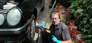Replace a leaking power steering hose on your car