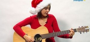 "Play the Christmas song ""Santa Claus is Coming to Town"" on guitar"