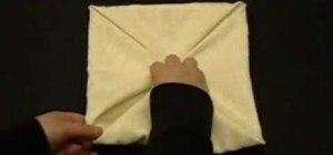 Fold an origami flower blossom napkin design