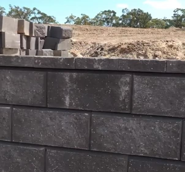 Stone Workers Play Dominoes with Bricks to Create Perfectly-Aligned Wall Cap