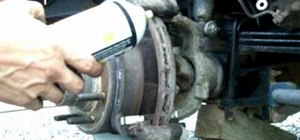 Lubricate the caliper pins or replace the brake pads on a Ford F-250 truck