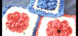 Crochet a loopy granny square with a flower motif