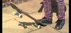 Stop your skateboard by powersliding or dragging your foot