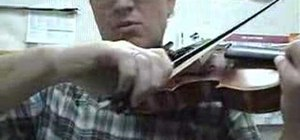 Learn finger stroke string crossings for the violin