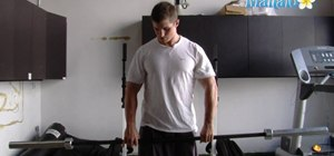 Do a front deltoid raise shoulder barbell exercise