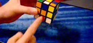 Solve the cross on the bottom of the Rubik's Cube