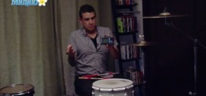 Play quarter notes on the drums
