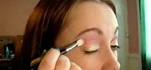 Apply soft gold and red eye makeup