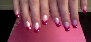 Do your nails in pink and white with hearts to celebrate Valentine's Day