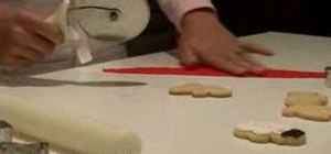 Decorate cute Christmas gingerbread man cookies with fondant