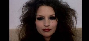 Apply Magenta (from Rocky Horror) costume makeup