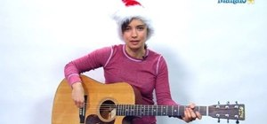 "Play ""Here Comes Santa Claus"" on the guitar for Christmas"