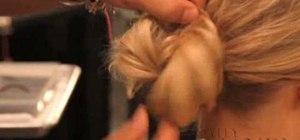 Create an elegant loose wedding day chignon