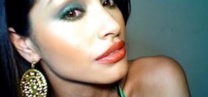 Create a green smokey eyes and bright lips makeup look inspired by Alicia Keys