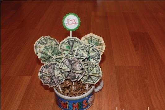 Money origami flower edition 10 different ways to fold a dollar the money boquet mightylinksfo