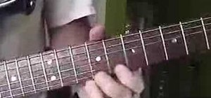Play pentatonic blues on the electric guitar