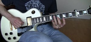 "Play ""Until the End of the World"" by U2 on electric guitar"