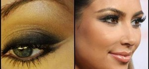 Create a double winged eyeliner look with Kim K