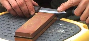 Sharpen a knife with a Japanese water stone