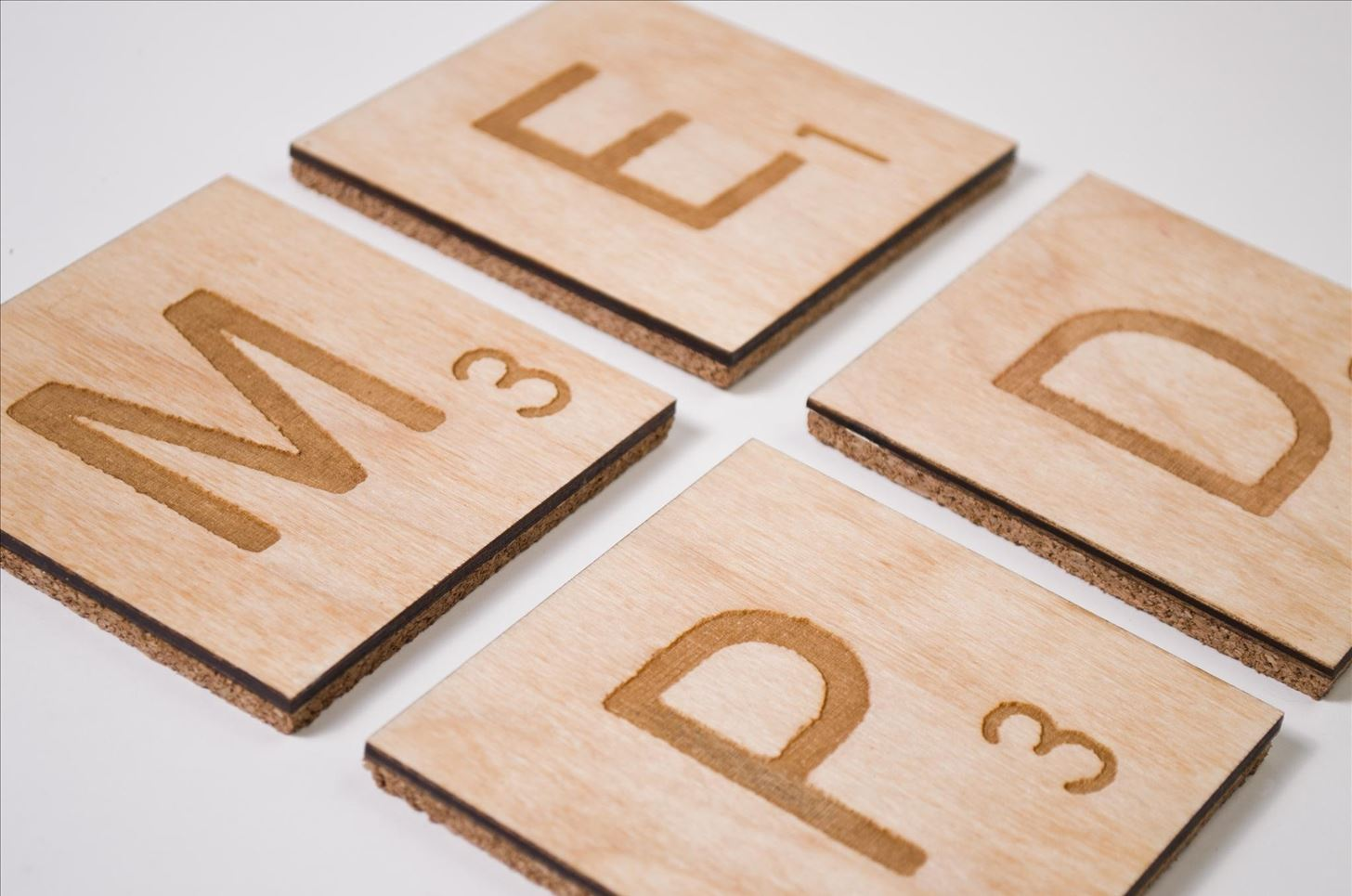 Laser-Etched Scrabble Coasters Look Like Legitimate Letter Tiles!